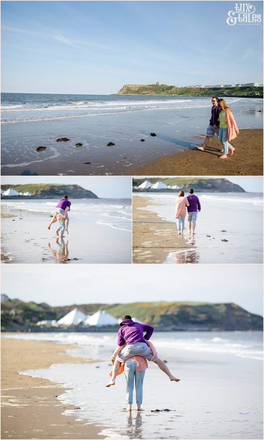 Couple playing in the ocean in North Beach in Scarborough