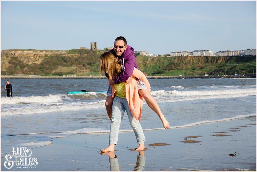 funny piggyback ride in Scarborough engagement shoot