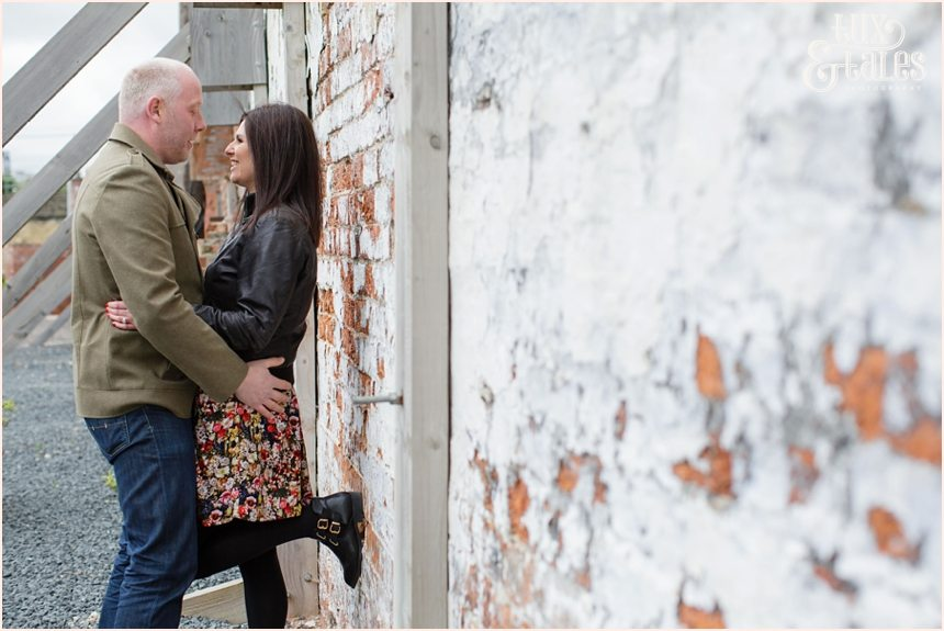 Brick wall and gorgeous couple at engagement shoot in leeds