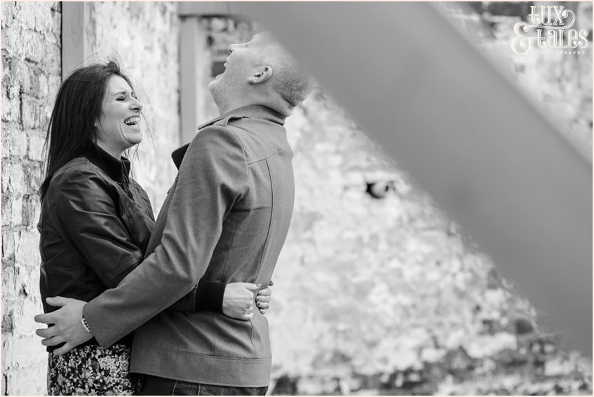 Laughing couple at engagement shoot