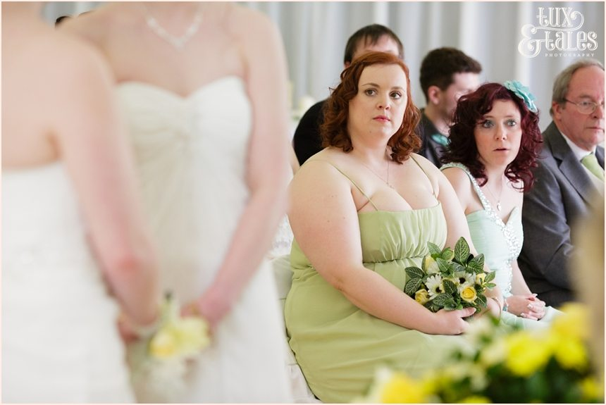 Bridesmaid looks on at wedding ceremony Regen Centre