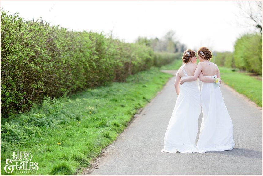 Two brides same sex wedding in York walking down leafy lane