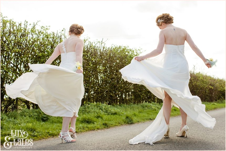 Two brides spinning in the streets same sex wedding photography York