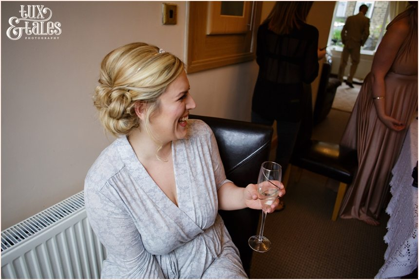 bride laughs as she gets ready at yorkshire wedding