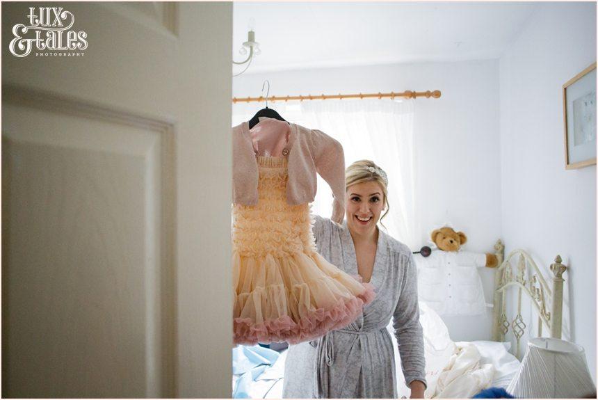Bride shows off bridesmaids dress at yorkshire wedding