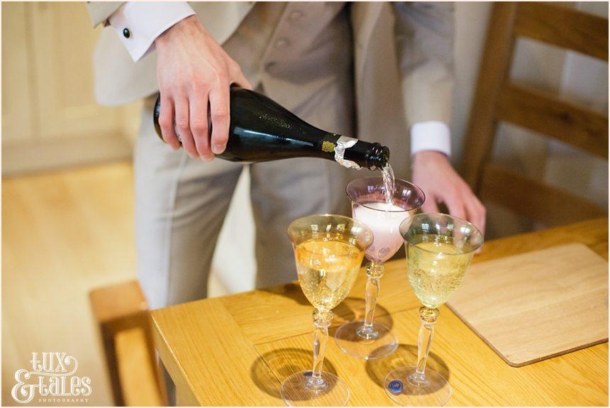 groomsmen poor champagne at yorkshire wedding