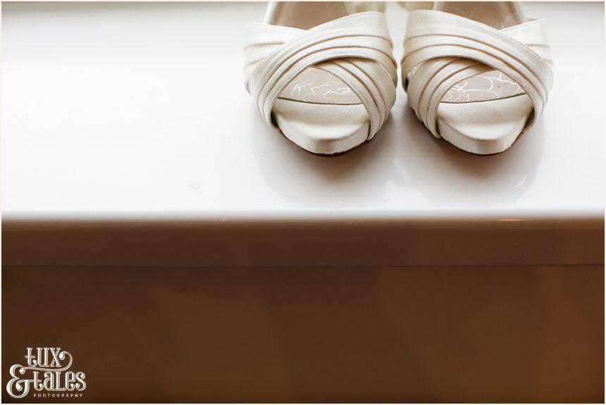 Photo of brides shoes at wedding preparation