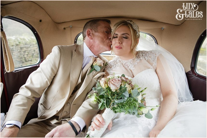 father kisses bride goodbye at yorkshire wedding