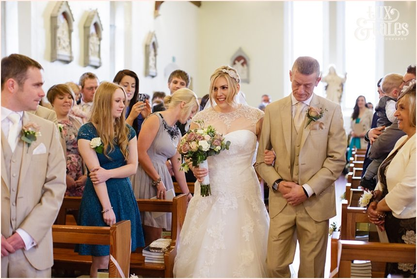 father walks bride up aisle at yorkshire wedding