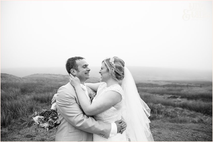 bride and groom embrace out on the west yorkshire moors