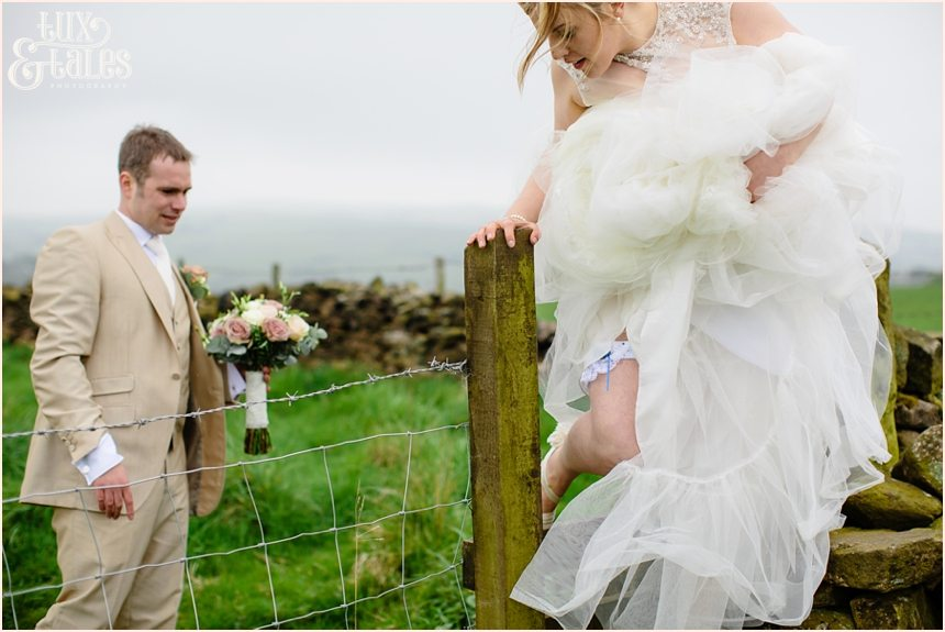bride hops fence at Alma Inn