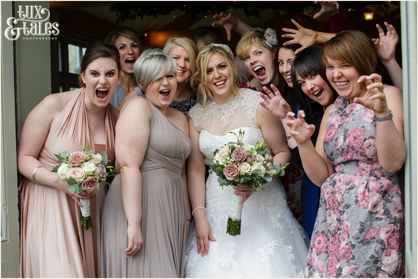 wedding guests make silly faces at wedding at The Alma Inn