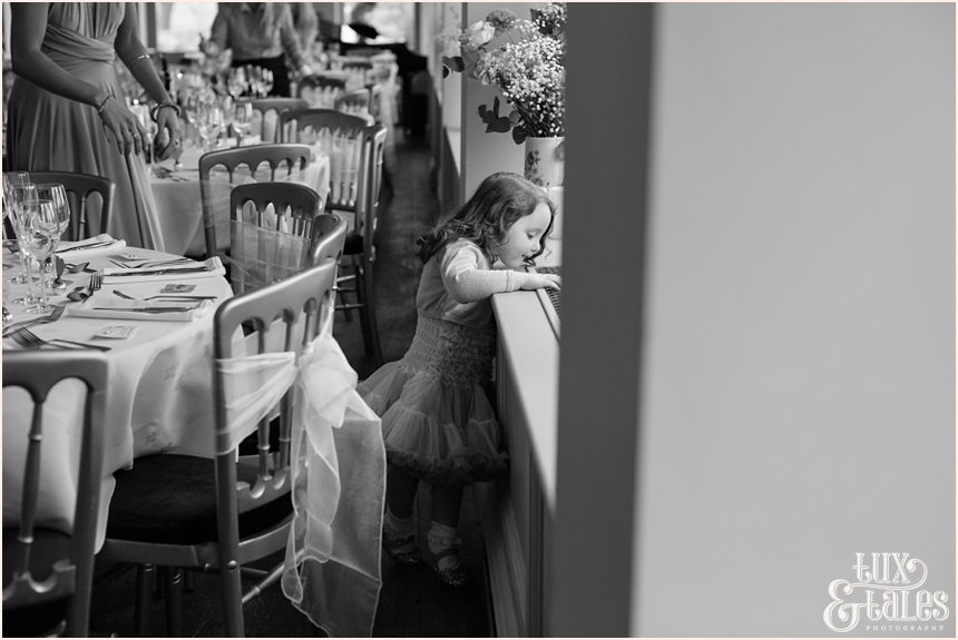 Little girl looks out the window at wedding at the Alma Inn