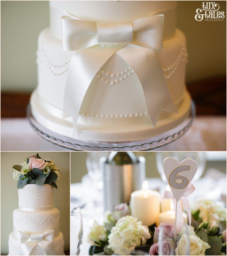 white bow-tie cake at wedding at Alma Inn