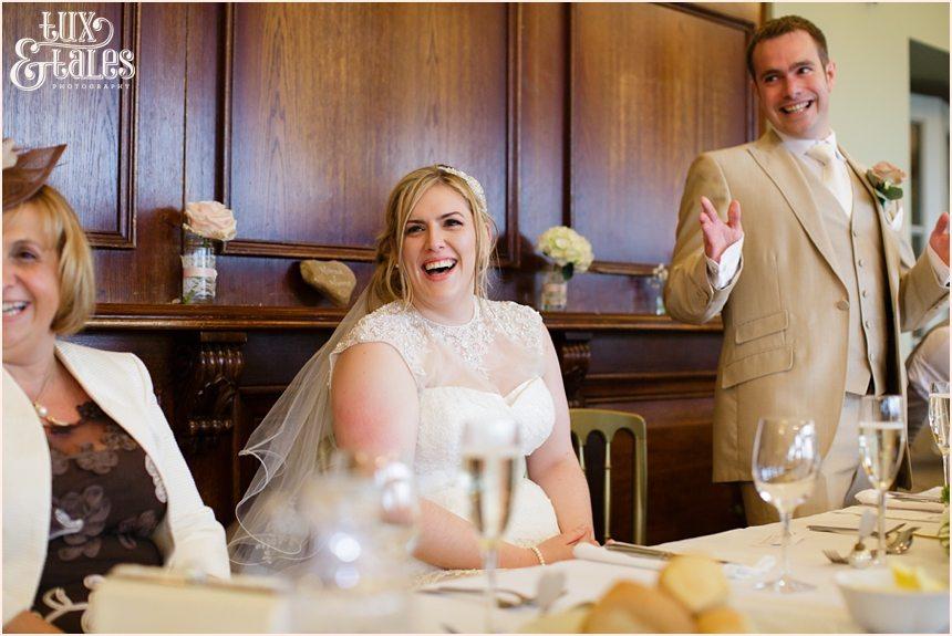 Bride laughs during speeches at The Alma Inn