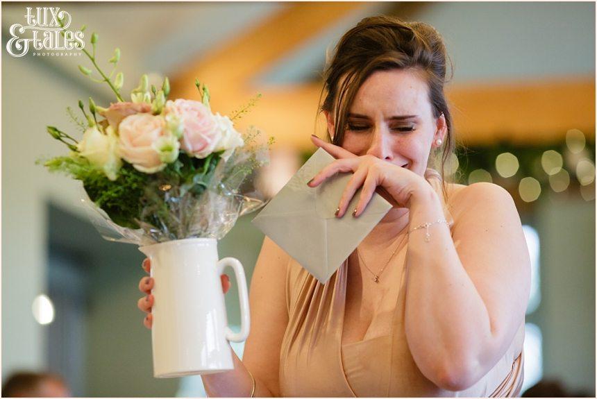 Bridesmaid cries when recieving gift