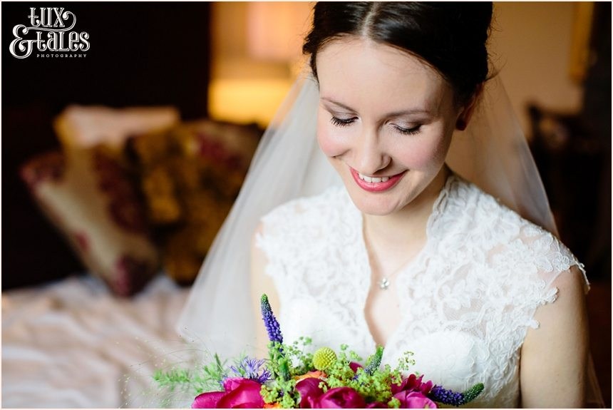 York wedding photography bride looks at brightly coloured bouquet