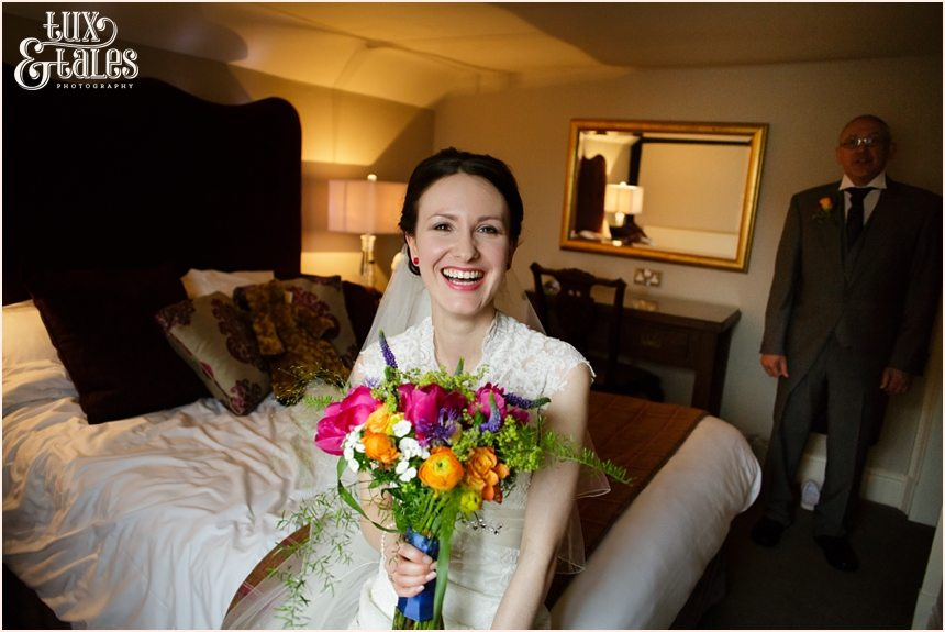 Bride smiles as she gets ready  for her wedding