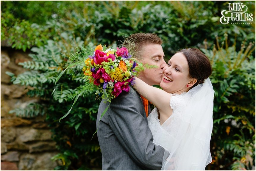 Yorkshire wedding photography groom kisses bride on the cheek