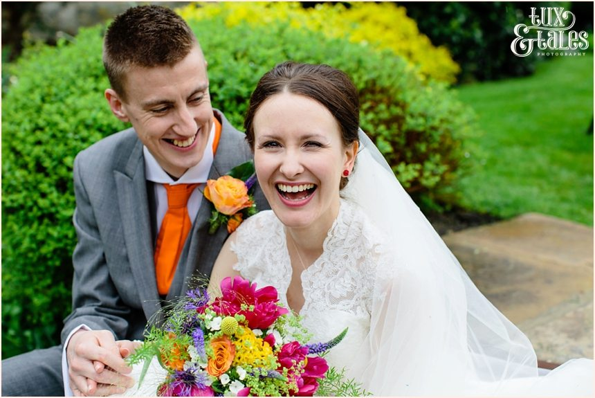 Bride and groom laugh and smile at Yorkshire wedding