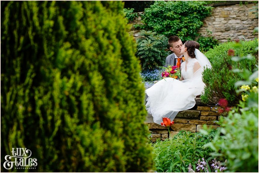 Bride & groom kissing at quirky wedding in yorkshire moors