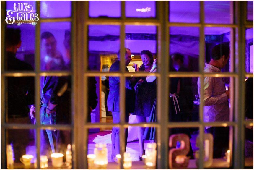 Wedding party photos taken through window at Yorkshire wedding