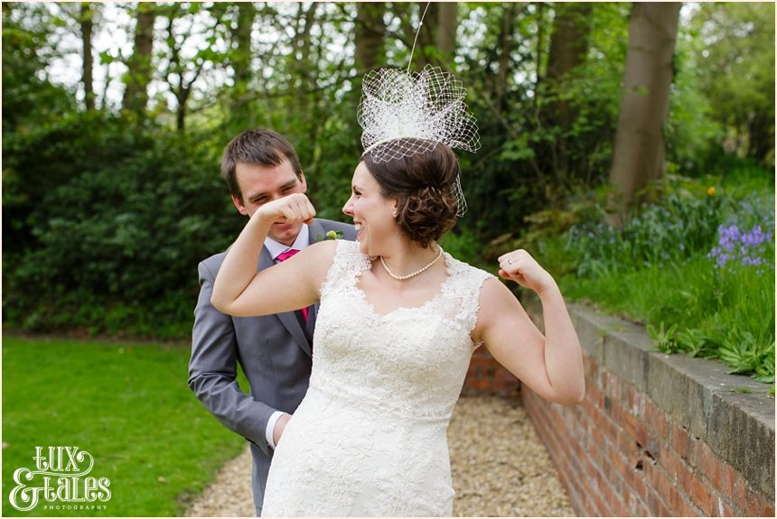 bride acts silly in wedding photos at the old swan hotel in harrogate