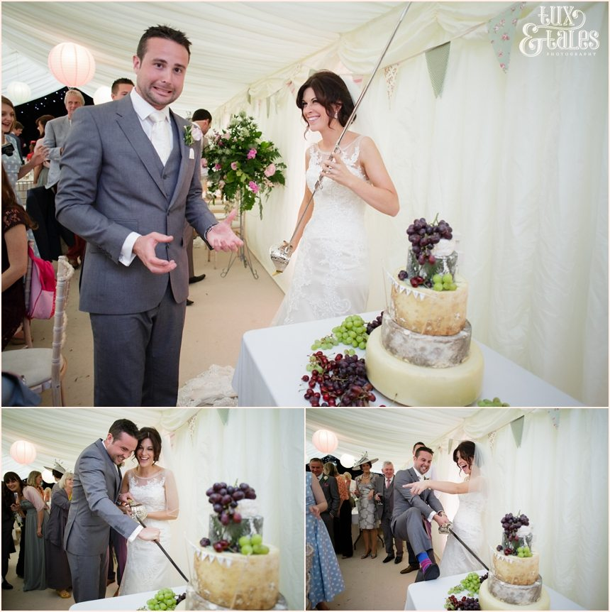 Silly photos of bride and groom cutting cheese cake at York wedding