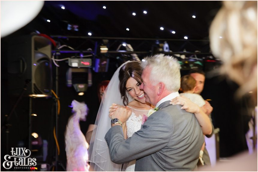 Bride and dad dance together at York wedding