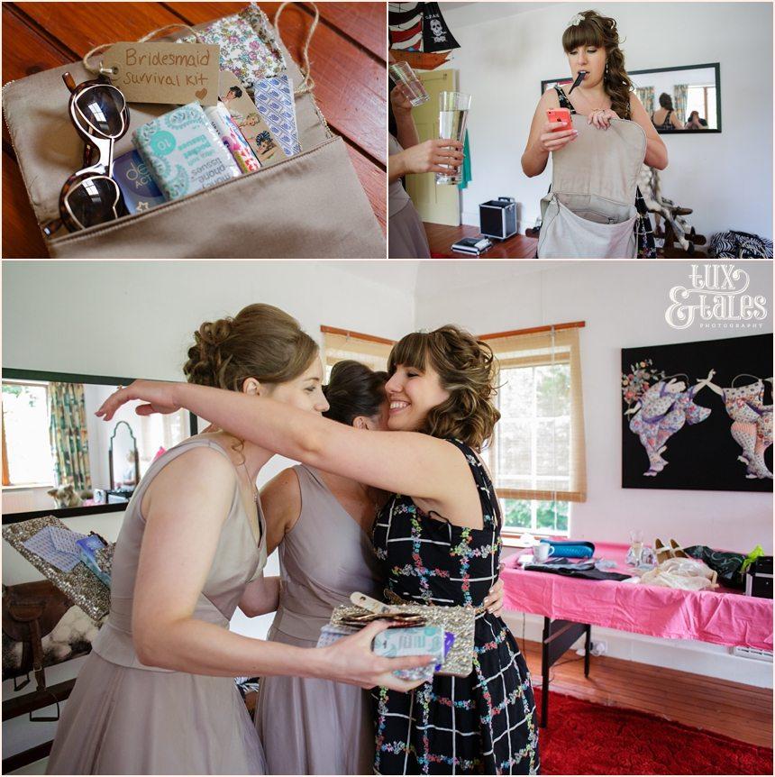 Bride hugs bridesmaids at Altchinham Wedding photography