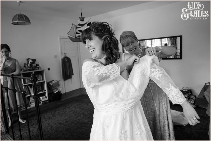 Bride gets into her lace wedding dress