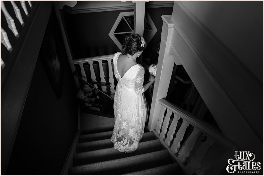 Bride walks down stairs Tux & Tales Photography