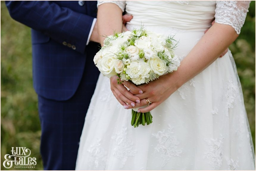 Bride holding bouquet at Altrincham wedding