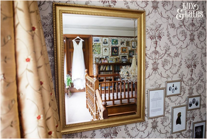 Woodlands B&B Wedding photographer Wedding dress in mirror Tux & Tales Photography
