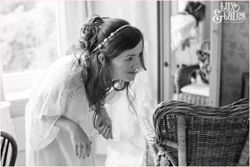 Relaxed, natural wedding photography woodlands B&B bride laughing