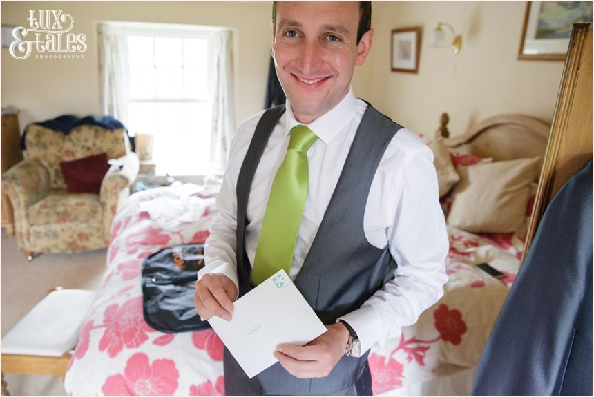 Groom opens letter from bride Newton Grange