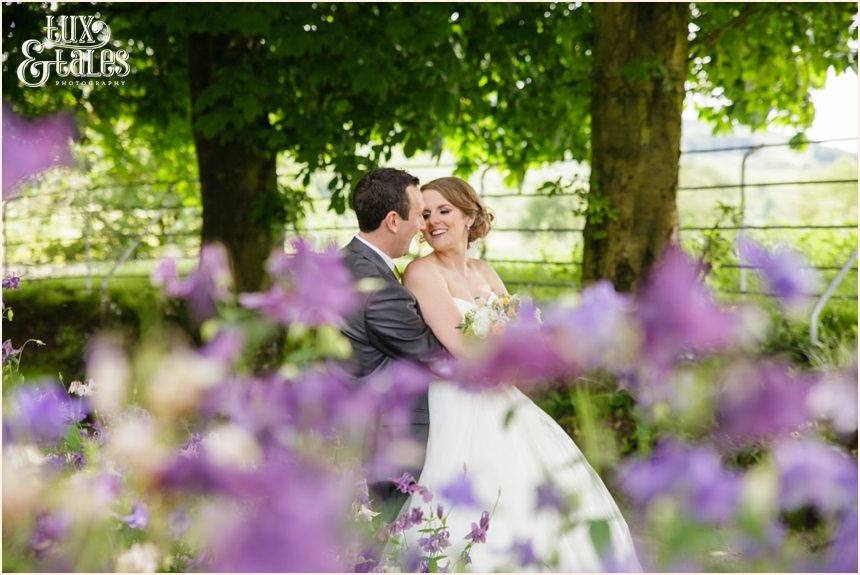 Relaxed informal documentary wedding photography at Taitlands behind flowers
