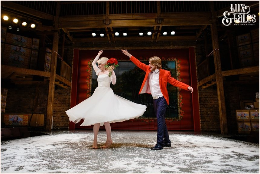 RSC Swan Theatre Wedding Photographer Royal Shakespeare Company twirling on the stage in the snow