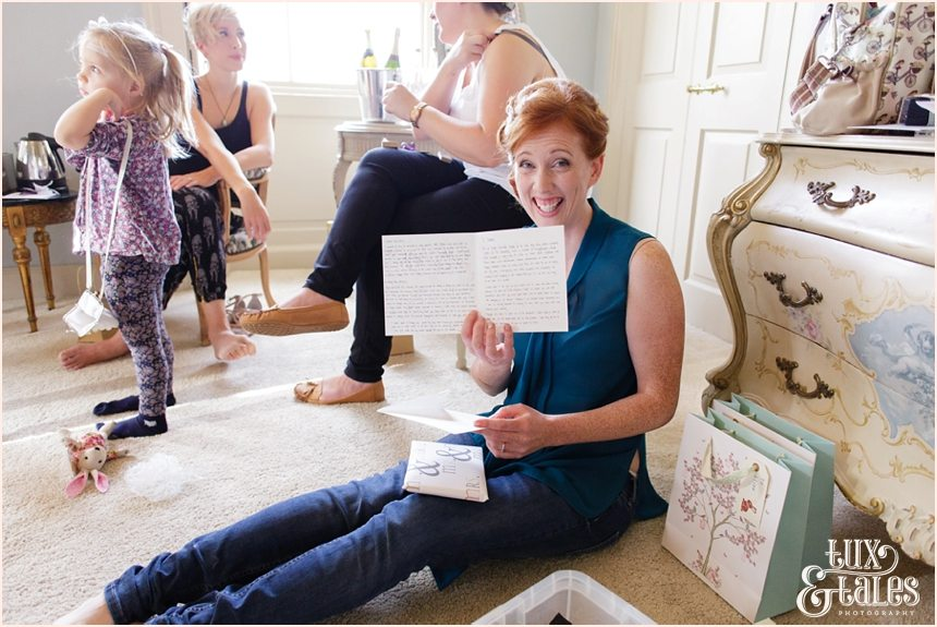 Bride Preparation Photography at Newton Hall beachside wedding | Showing letter