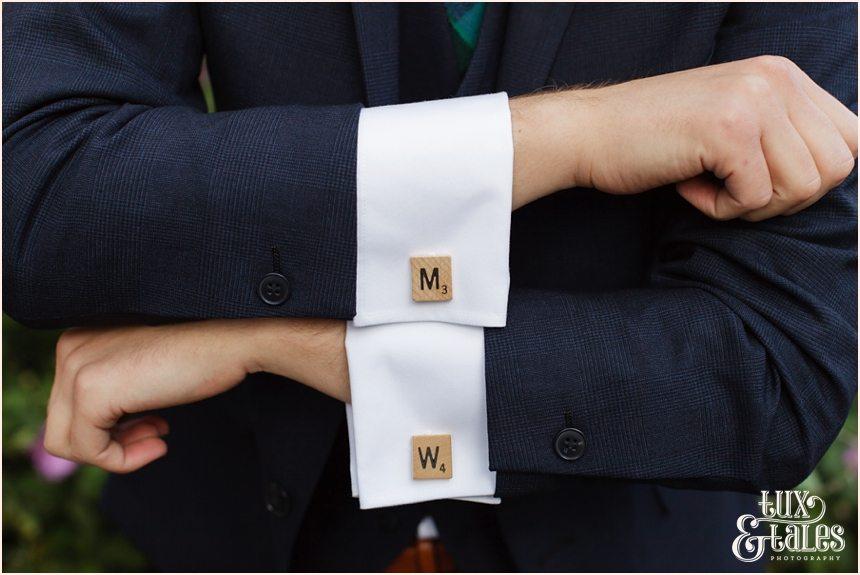 Groom Preparation Photography at Newton Hall beachside wedding | Scrabble cufflinks