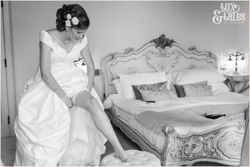 Bride Preparation Photography at Newton Hall beachside wedding | Putting on Garter