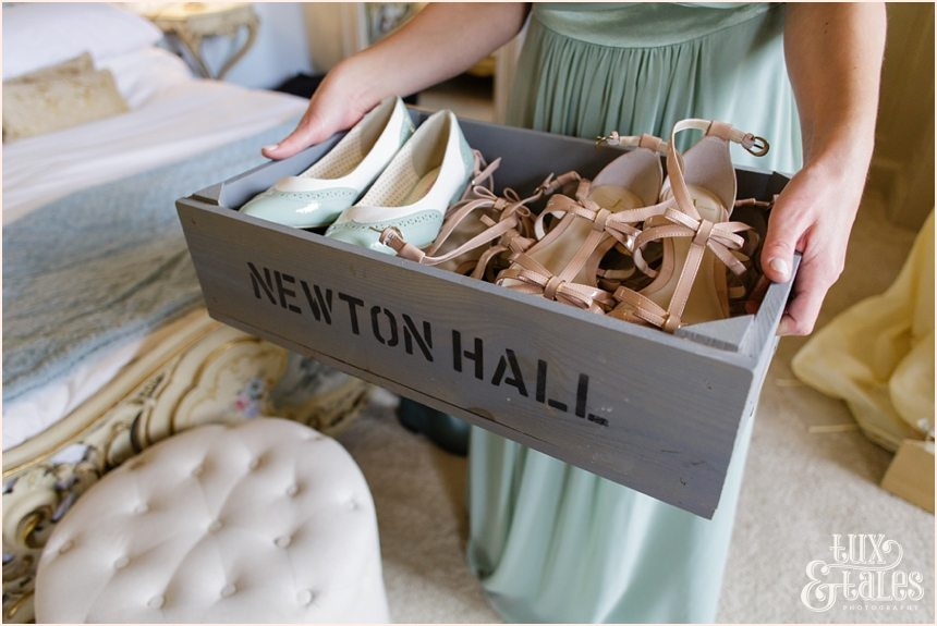 Bride Preparation Photography at Newton Hall beachside wedding | Crate of shoes