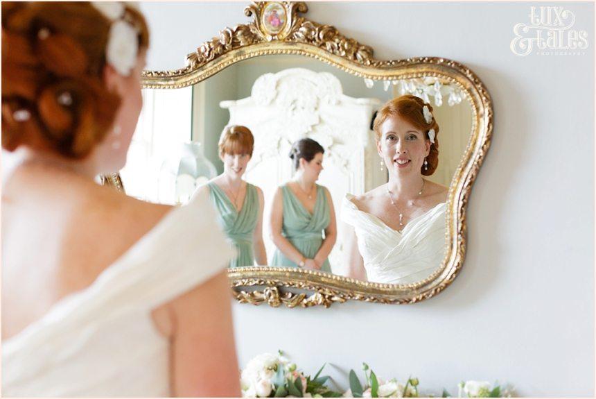 Bride Preparation Photography at Newton Hall beachside wedding | Bride looks in mirror