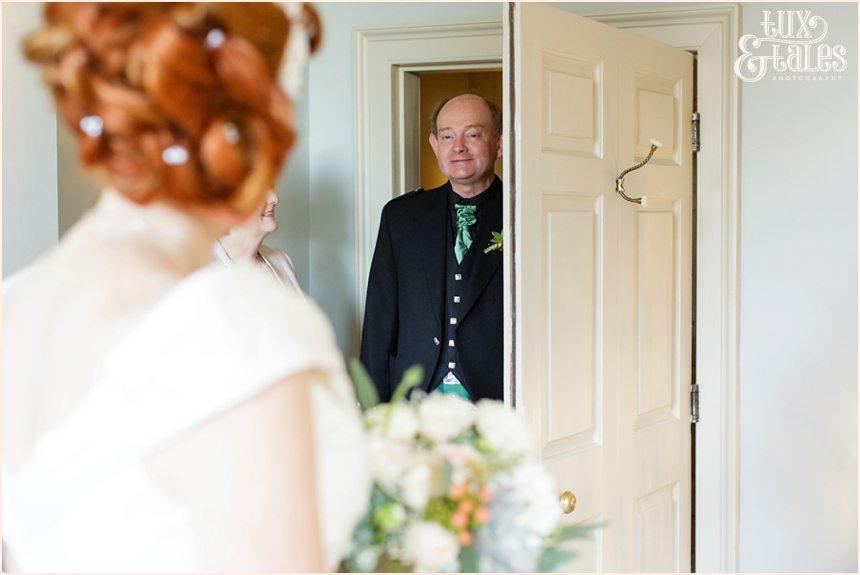 Bride Preparation Photography at Newton Hall beachside wedding | Dad looking at bride