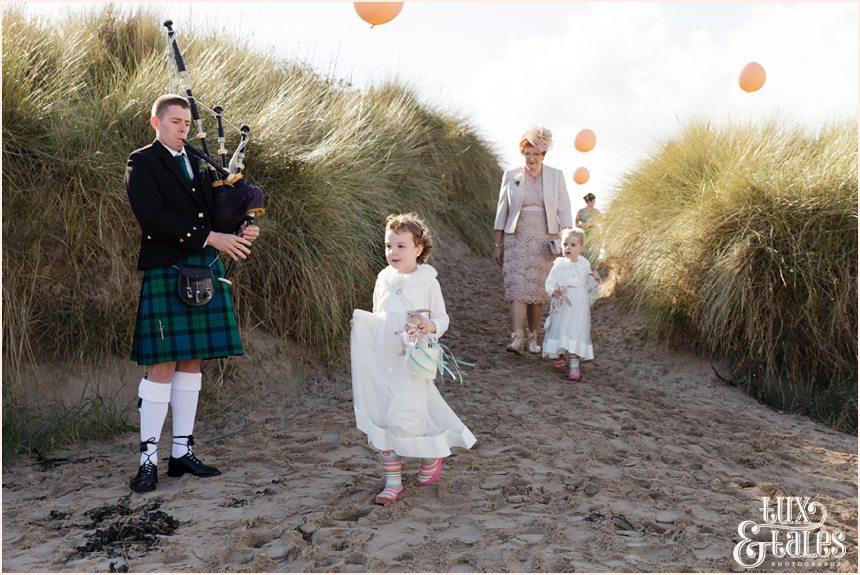 Ceremony Photography at Newton Hall beachside wedding | Flower Girl