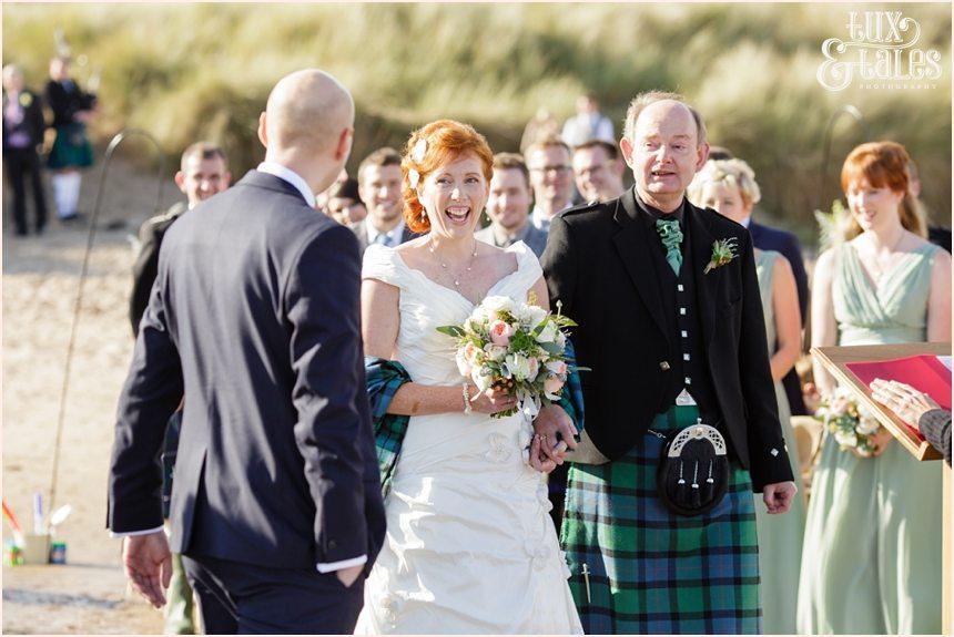 Ceremony Photography at Newton Hall beachside wedding | Blue green tartan