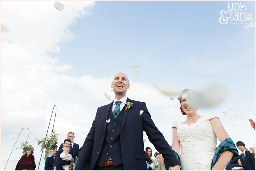 Ceremony Photography at Newton Hall beachside wedding | Exiting