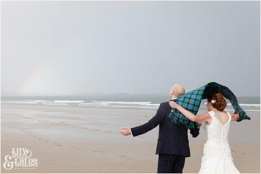Bride & Groom Portraits in the rain at Newton Hall beachside wedding photography | Rainbow