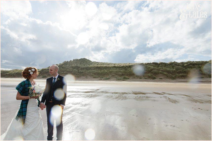Bride & Groom Portraits in the rain at Newton Hall beachside wedding photography