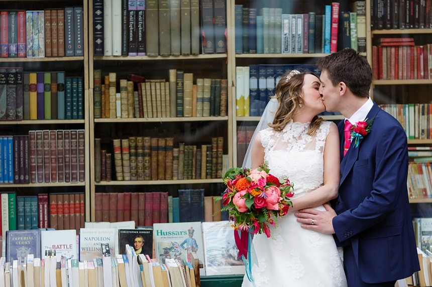 York Wedding Photography burde in front of book shop with colourful bouquet